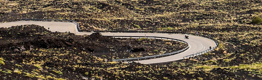road carved through the lava fields on Etna - Sicily